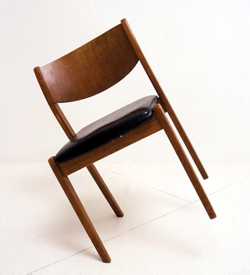 james hopkins artist sculpture slanted chair balance