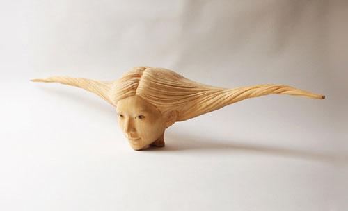 wood sculptures by artist yasuhiro sakurai