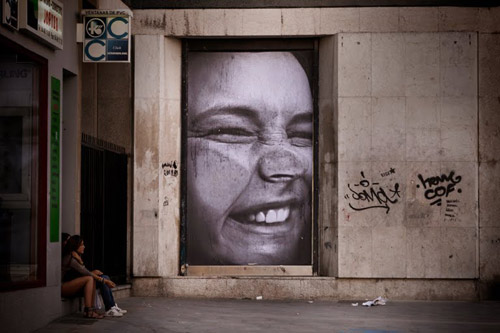 Photographic wheat pastes by street artists Mentalgassi