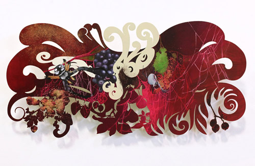 Intricately cut paintings by artist painter Resa Blatman
