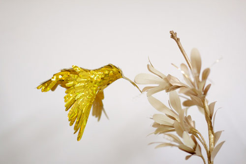 gold hummingbirds by Diana Beltran Herrera