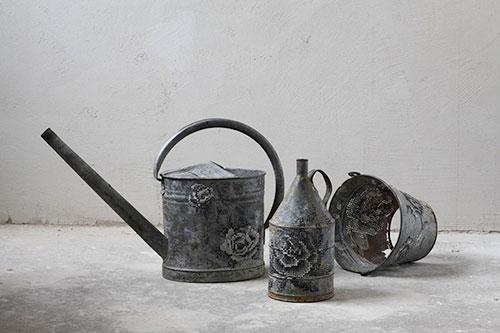 Severija Inčirauskaitė-Kriaunevičienė cross stitching in metal objects
