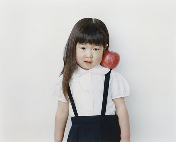 portraits of japanese kids with fruit on their shoulders