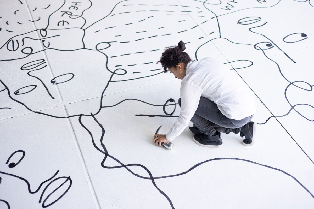 Artist Shantell Martin at work